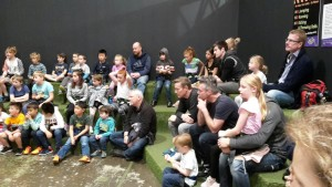dads and kids in clip n climb saftey briefing