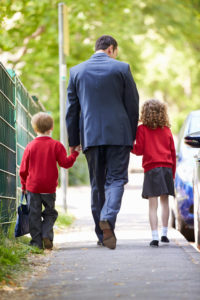 Father Dropping Kids Of At School On Way To Work
