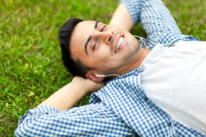 Young man relaxing on the grass