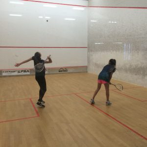 girls playing squash
